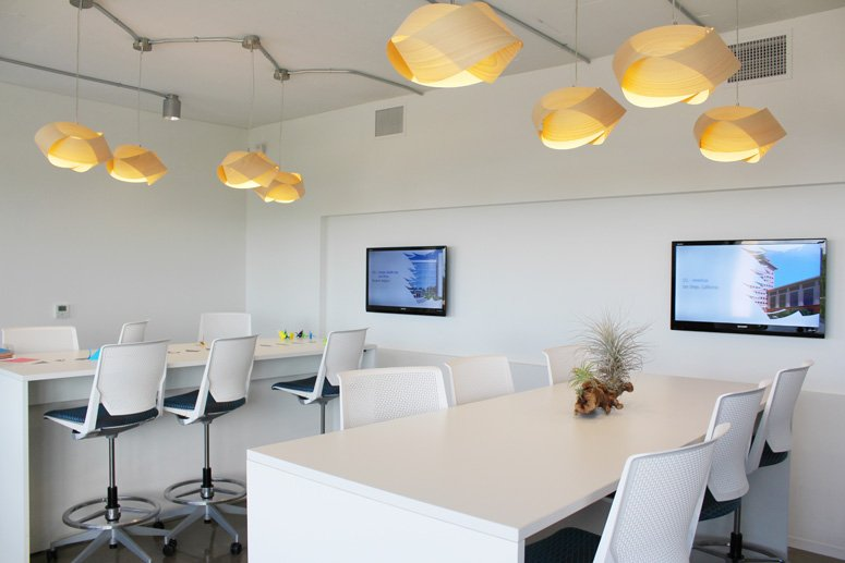 Bar top seating and a paper crane folding station create the perfect setting for serendipitous meetings.