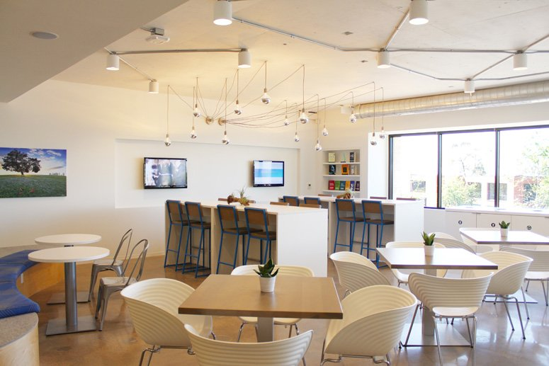 The center's spacious lunchroom offers comfy seating and ocean views to help participants in its leadership programs relax and recharge.