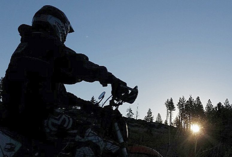 SVP Dave Bates watched the sun rise from his dirt bike while camping in the Sierras.